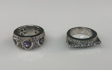 2 Sterling silver rings.
