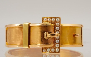 297-An articulated bracelet in yellow gold, the simulated buckle adorned with fine half-pearls.