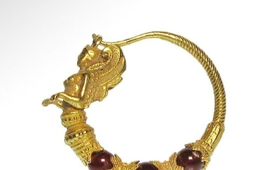 Greek Gold and Garnet Earring with Sphinx, c. 3rd-2nd