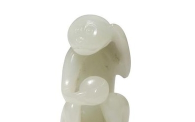 A SMALL CHINESE WHITE JADE CARVING OF A MONKEY QIA…