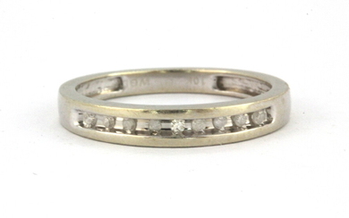 A 10ct white gold (stamped 10K) diamond set half eternity ring, (N).