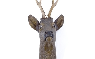 A Black Forest carved and painted wood wall-mounted deer's h...