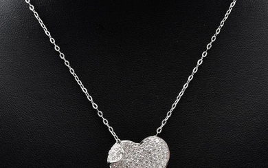 A DIAMOND PENDANT-The heart saped pendant, pave set with round brilliant cut diamonds totalling 1.40cts, attached to a fine link cha...