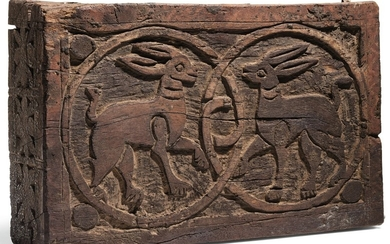 A FATIMID CARVED WOODEN PLAQUE WITH TWO HARES, EGYPT, 11TH-12TH CENTURY