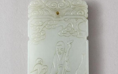 A GOOD CHINESE CARVED CELADON JADE PENDANT, carved to