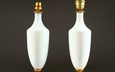 A PAIR OF 19TH CENTURY WHITE GLASS TABLE LAMPS. 15ins