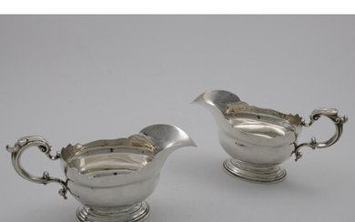 A PAIR OF EARLY 20TH CENTURY SAUCE BOATS in the early George...