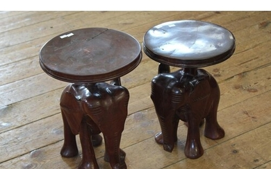 A Pair of Elephant Tables Carved in Hardwood with Circular T...