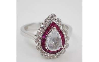 A diamond and ruby cluster ring set in 18ct gold, centre dia...