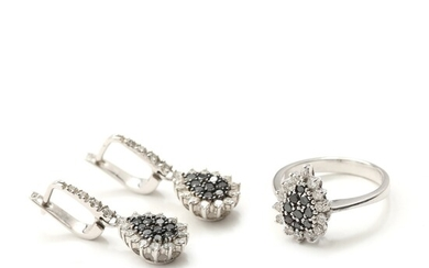 NOT SOLD. A diamond ring and earrings set with numerous brilliant-cut black and white diamonds,...