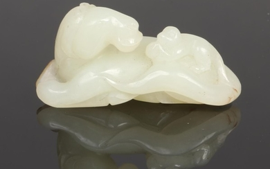 A late 19th century Chinese pale celadon jade carving. Forme...
