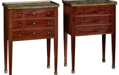 A pair of Neoclassical mahogany veneered side tables,...