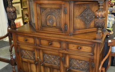 A reproduction carved oak court cupboard in the 17th Century...