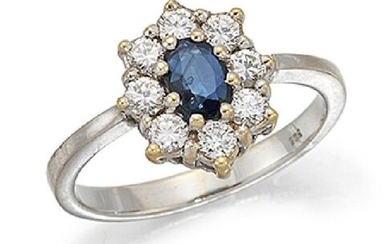 A sapphire and diamond cluster ring, the claw-set...