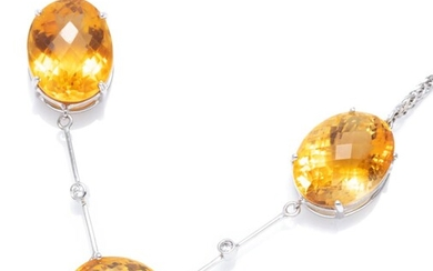 AN 18CT WHITE GOLD CITRINE AND DIAMOND NECKLACE; set in line with 3 oval cut chequerboard citrines totalling approx. 31.00cts with 2...