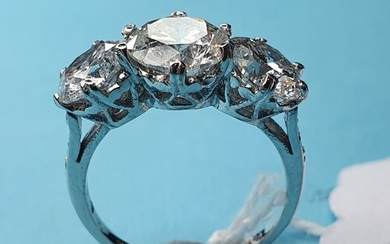 An 18ct white gold and three stone diamond ring, 3.84ct, app...