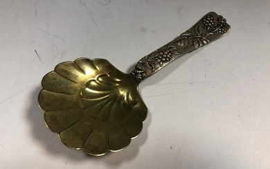 An American metalwares conserve spoon by Tiffany