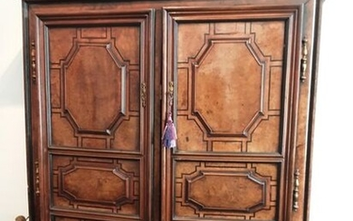 Cabinet in walnut, burr-walnut, frames underlined with ebony filets and...