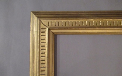 Carved wood frame, gilded with an inverted profile...