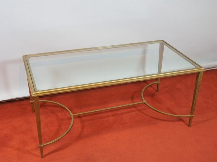 Coffee table, the structure in gilt bronze, resting on 4 legs joined by a spacer, the glass top, circa 1960