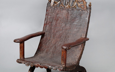 Colonial armchair, probably Mexican, in carved, polychrome and gilt wood, upholstered in embossed and studded leather, early 18th Century.
