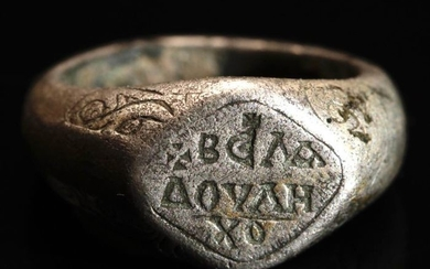 Early medieval Silver Significant Ring with Greek inscriptions ΒΕΛΑ ΔΟΥΛΗ ΧΟ in Niello and a Cross on the Rhombic Bezel.