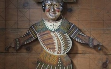 Life-size puppet with articulated arms and legs moved...