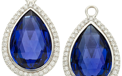 Tanzanite, Diamond, White Gold Ear Pendants The ear pendants...