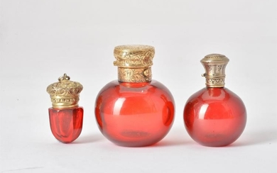 Two 19th century ruby glass spherical scent bottles and a ruby glass vinaigrette