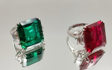 Two RINGS in 14 karat white gold (585‰) set with white, green and red imitation stones, cut in steps.
