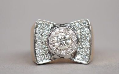 Yellow gold tank ring with diamonds in the shape of a bow tie.