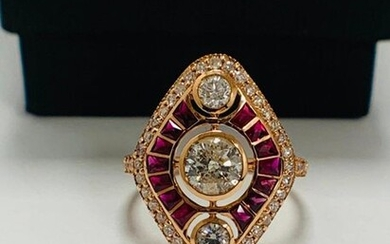 14ct Rose Gold Ruby and Diamond ring featuring centre, round brilliant cut Diamond (0.51ct), bezel set, with 2 round brilliant cut Diamonds (0.18ct TDW), bezel set, as well as 14 french cut Rubies (0.76ct TSW), and 42 round brilliant cut Diamonds...