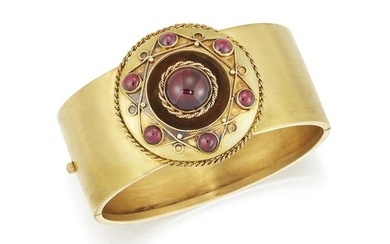 A 19TH CENTURY GARNET BANGLE, the 25mm wide hinged