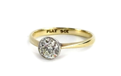 A 9ct gold and platinum diamond solitaire ring, set with rou...