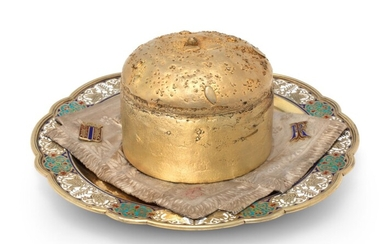 A CHAMPLEVÉ ENAMEL PARCEL-GILT SILVER TROMPE L'OEIL BREAD AND SALT DISH, MARKED LYUBAVIN WITH IMPERIAL WARRANT, MOSCOW, CIRCA 1870