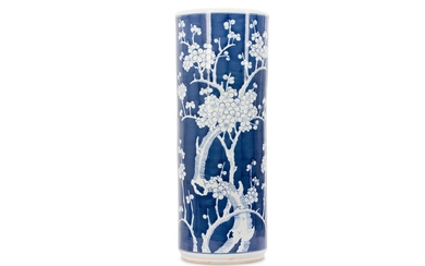 A CHINESE BLUE AND WHITE 'PRUNUS' UMBRELLA STAND.