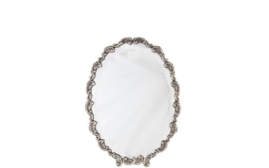 A CONTINENTAL STERLING SILVER OVAL FRAMED MIRROR, fitted bez...