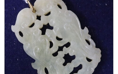 A Chinese carved pendant.