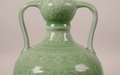 A Chinese green glazed porcelain garlic head flask with two ...