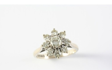 A DIAMOND CLUSTER RING of flowerhead design, the central bri...