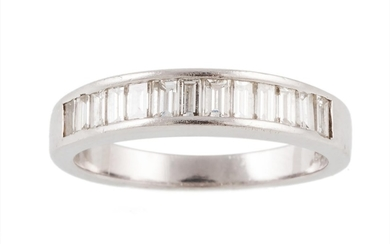 A HALF ETERNITY DIAMOND RING, with baguette cut diamonds of ...
