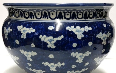 A LARGE 19TH CENTURY CHINESE BOWL Decorated with prunus on ...