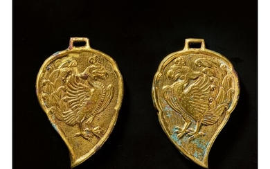 A PAIR OF LEAF-FORM GILT-BRONZE 'PHOENIX' PLAQUES, LIAO DYNASTY