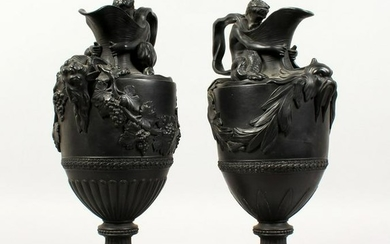 A PAIR OF WEDGWOOD BLACK BASALT EWERS, emblematic of