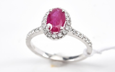 A RUBY AND DIAMOND CLUSTER RING IN 18CT WHITE GOLD, RING SIZE P