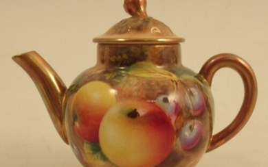 A Royal Worcester miniature tea pot, decorated with fruit by...