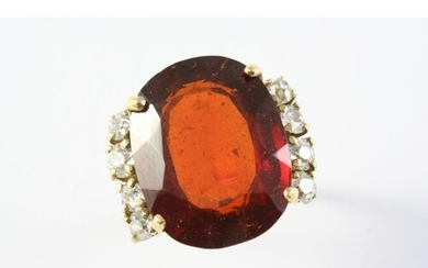 A SPESSARTITE GARNET AND DIAMOND RING the large oval-shaped ...