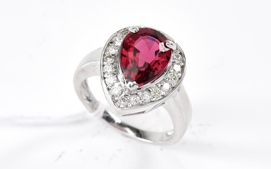 A TOURMALINE AND DIAMOND RING-The pear cut pink tourmaline weighing 2.88cts, surrounded by round brilliant cut diamonds totalling 0....