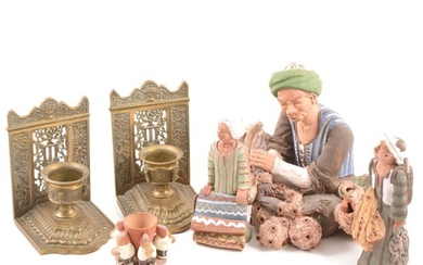 A collection of Peruvian figures, a brass pocket compass and a pair of cast brass book ends.