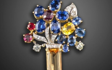 A gem-set giardinetto brooch by Boucheron, set with an orange topaz base, the flowers set with sapphires, rubies and diamonds in platinum and gold, signed, 4.6cm high